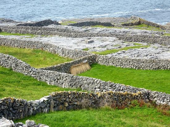 Dry stone walled fields and karst limestone terrain.